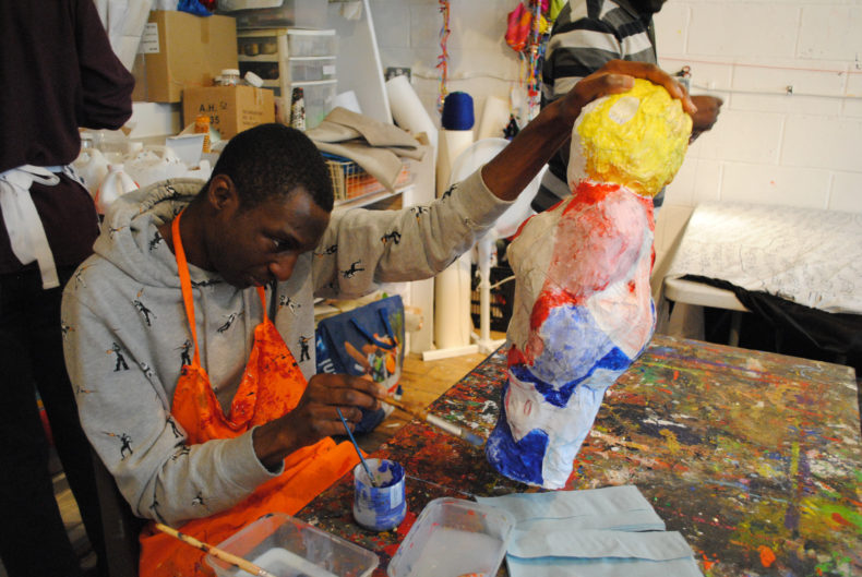 Adam Crown making paper mache