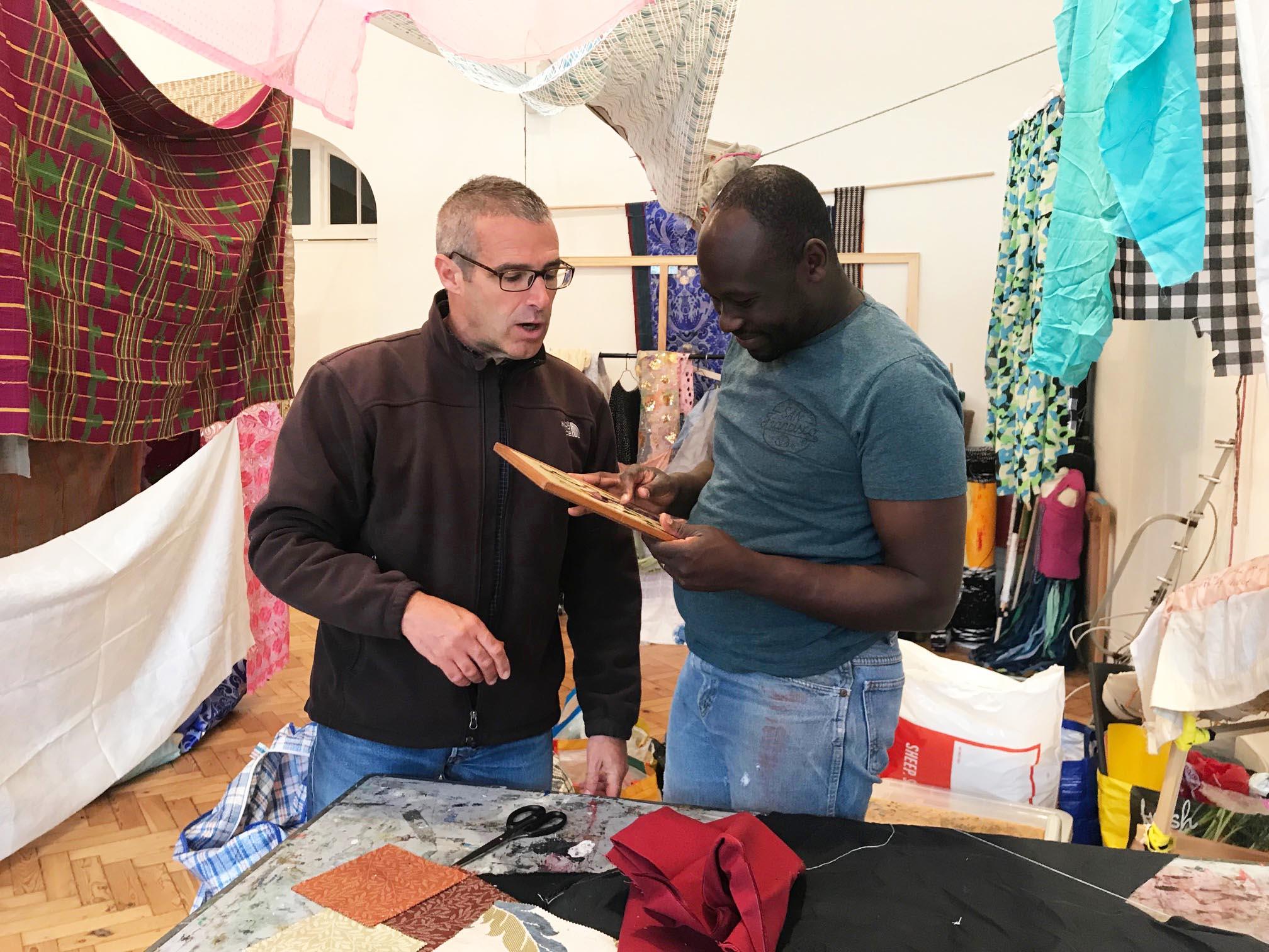 Andrew Omoding with artist Professor Trevor H.J. Marchand