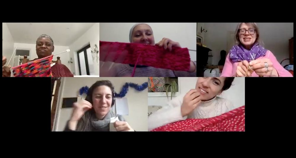 Zoom image of five people holding up their knitting and sewing