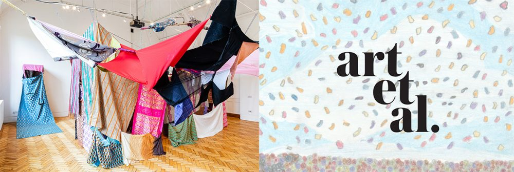 An installation of suspended fabric and objects