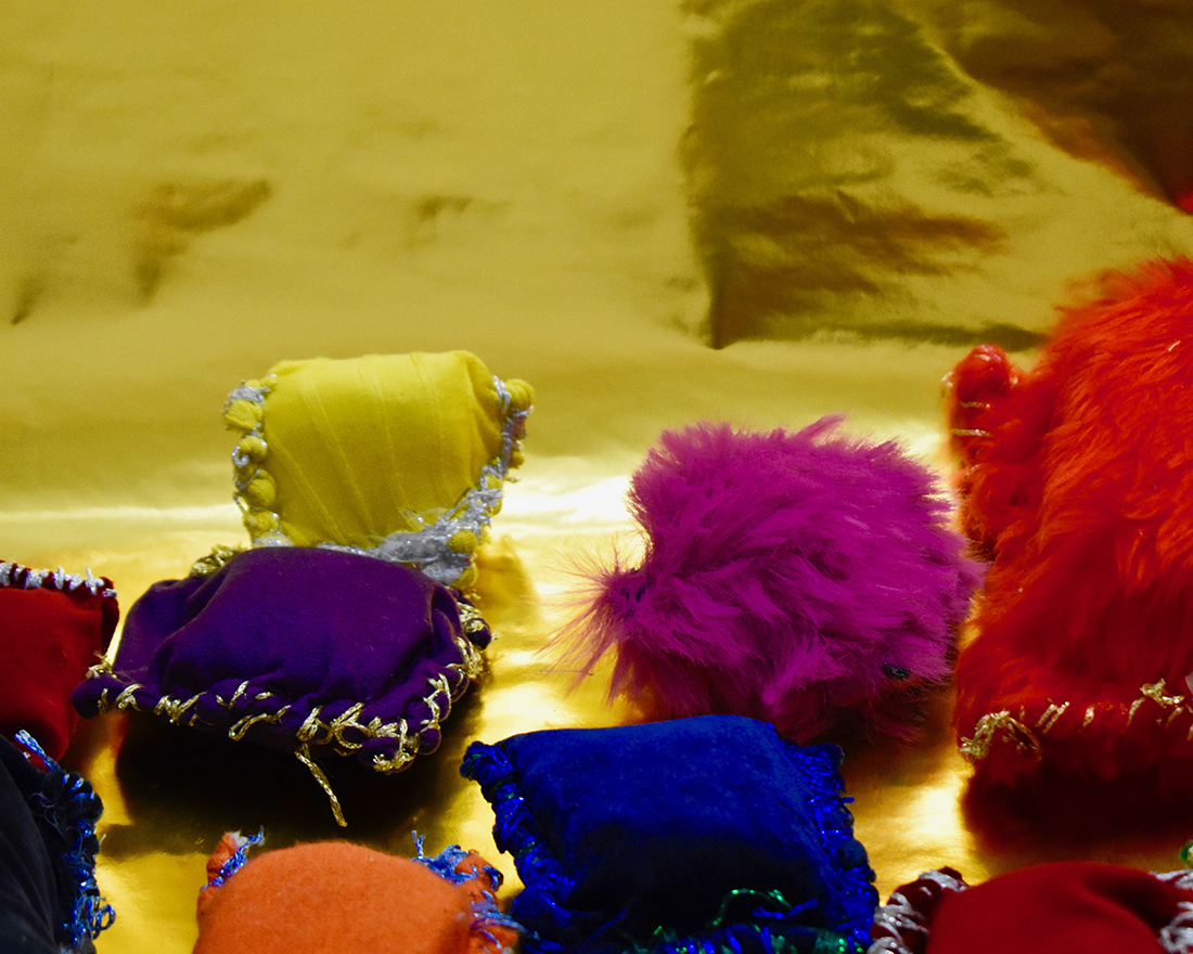 Small textile cushion like sculptures made from different coloured fabrics