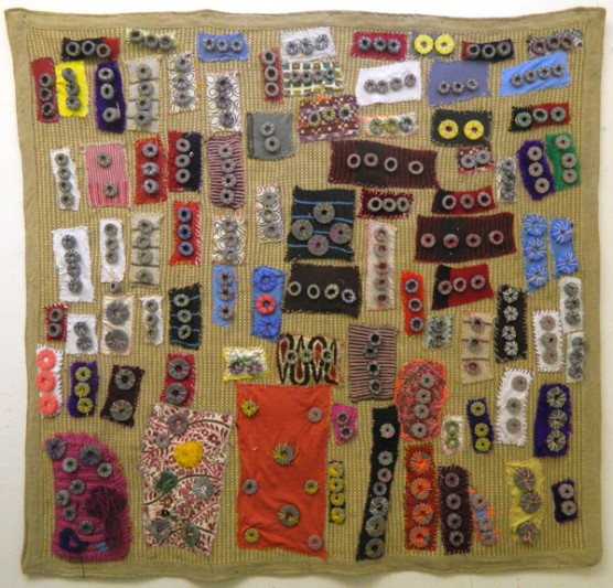 Large textile work made up of small coloured pieces of fabric