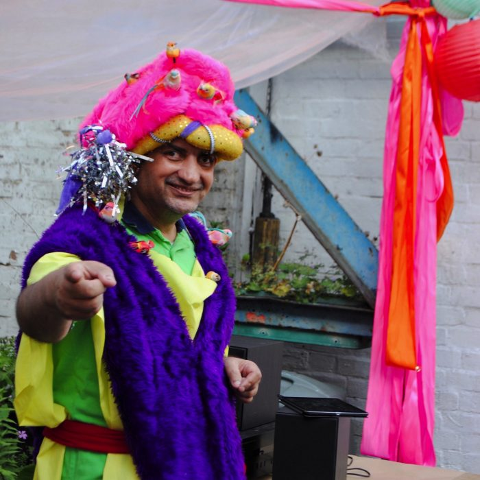 Pardip Kapil wearing a brightly coloured outfit and headdress for Pop Up Pardip