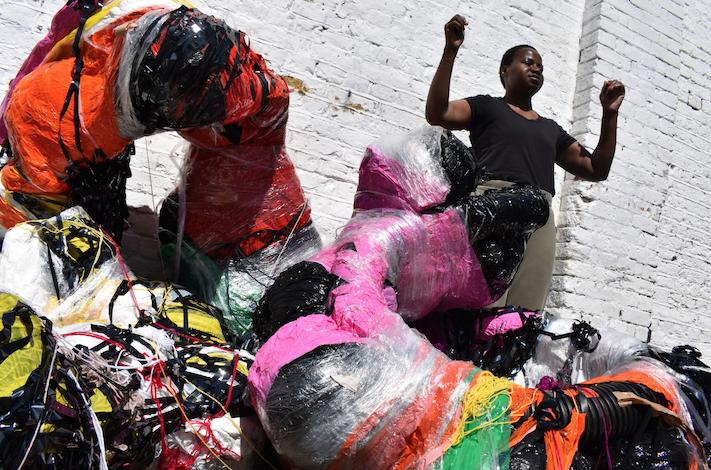 ActionSpace artist Nnena Kalu standing amongst her sculptures